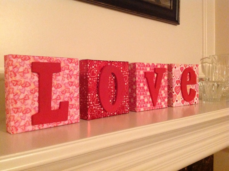 Valentine decor. Martha Stewart paper Mod Podged onto canvas blocks. Painted letters glued on.