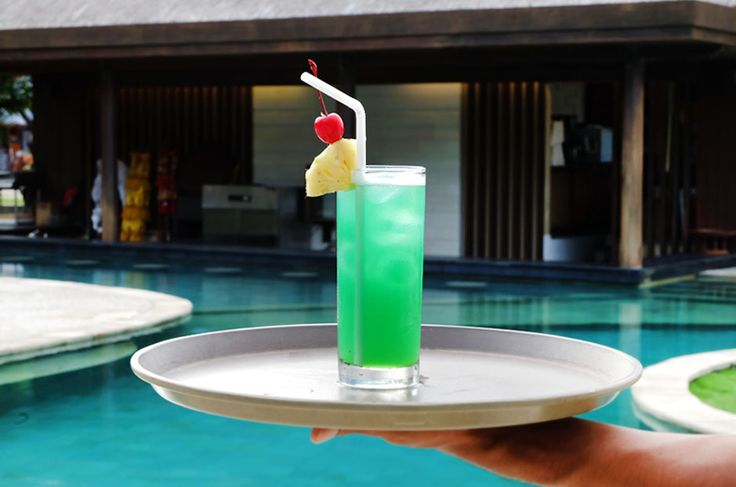 Quench your thirst while relaxing by the pool. What could be better than this? Tag 2 friends you'd love to spend a relaxing day like this with!  www.benoaresort.com  #thetanjungbenoa #thetanjungbenoabeachresortbali #TheTAOBali #bali