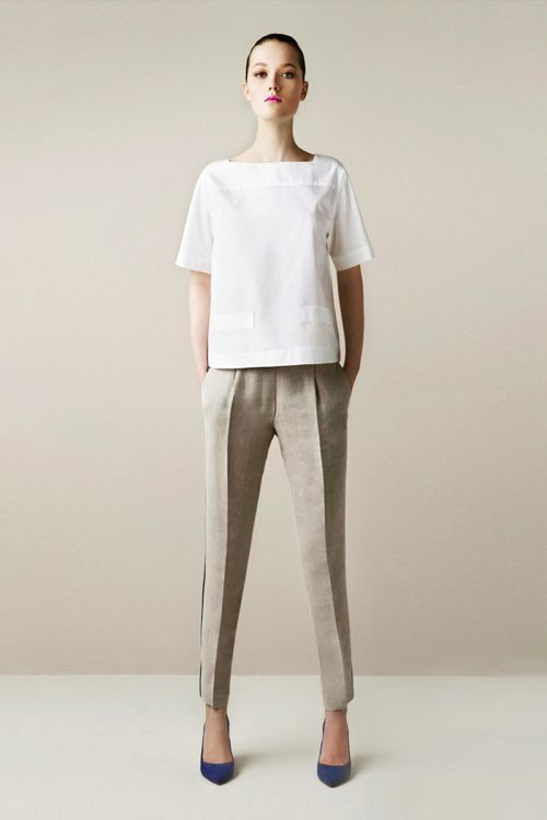 The simplicity of the dress and that line on the pants just makes a powerful statement. That's organization and strictness without the words.