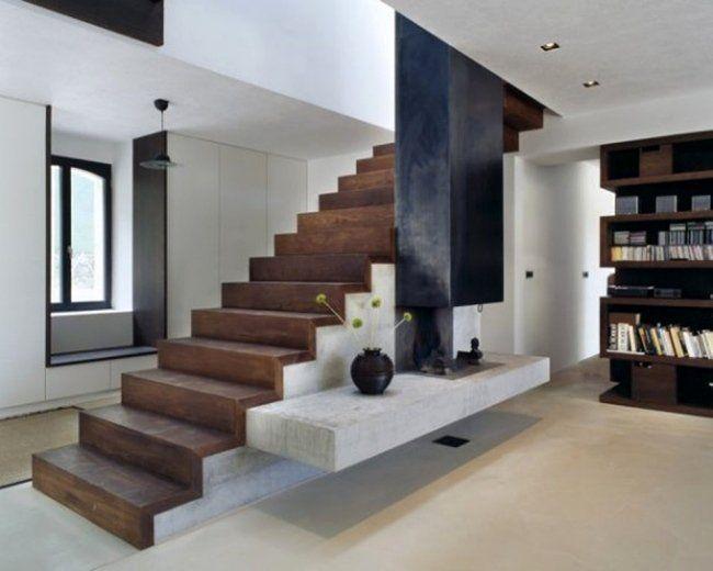 un escalier en bois et béton dans le salon moderne