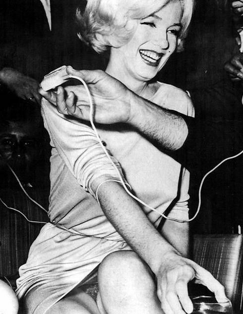 This rare, iconic image of Marilyn taken at a social event in Tijuana, Mexico in 1962. Peek in the gap of her dress, she unknowingly exposed herself and it was caught on film.