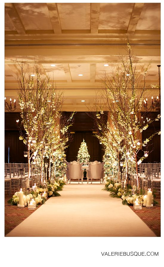 very pretty maybe some trees with lights in the entry to the church??? Glamorous wedding ceremony....