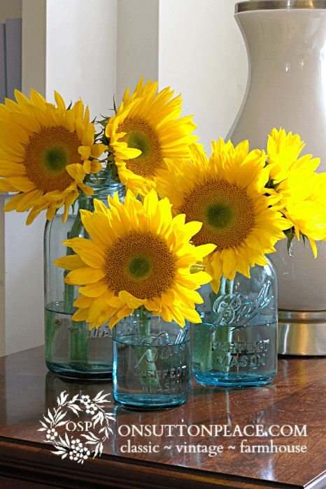 Sunflowers in Blue Ball Jars | Fun ways to add sunflowers to your decor!