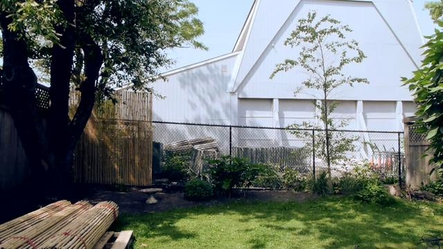 Attaching a Bamboo Friendly Fence to a Chain Link Fence by Bamboo Fencer. This is about as simple as fence installations go. We wired an 8 ft. Bamboo Friendly Fence directly to an old chain link to add privacy and style to this backyard. Fence panels available at http://www.bamboofencer.com.