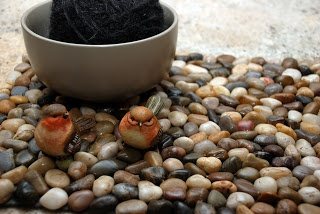 Cool pebble mat made out of rocks from the Dollar Tree ... I already have extras of these I got for the aquarium.
