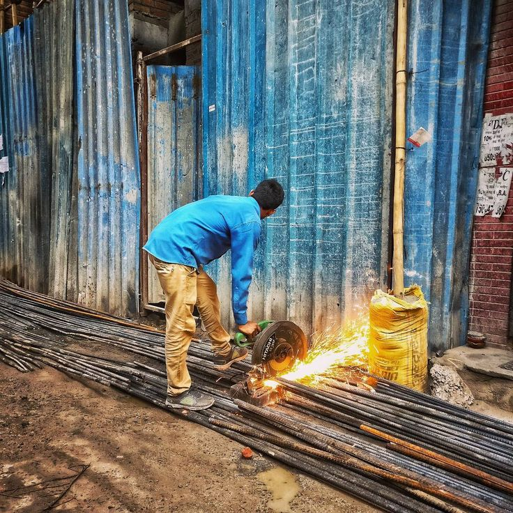 A man cuts iron rods at a construction site in Delhi India.  #iron #rod #construction #delhi #india #architecture #color #everydayeverywhere #everydayindia #photojournalism #indiaphotoproject #indiaphotostory #dailylife #street #myfeatureshoot #hikaricreative #huffpostgram #cnn #dfordelhi #saadidilli #sodelhi #creativeimagemagazine #reportagespotlight #shotononeplus #natgeo #lonelyplanetmagazineindia  #balkancollective #lensculture #1415mobilephotographers #photocommune
