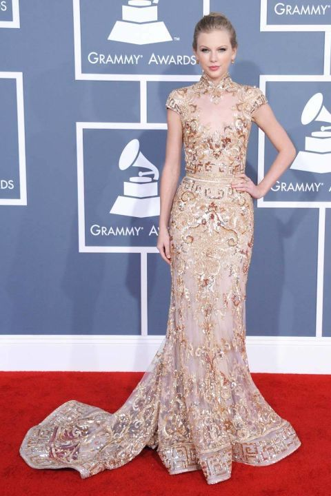 In Zuhair Murad at the 54th Annual Grammy Awards in L.A. See Taylor Swift's full fashion evolution, from sequins in 2007 to her many crop tops today.