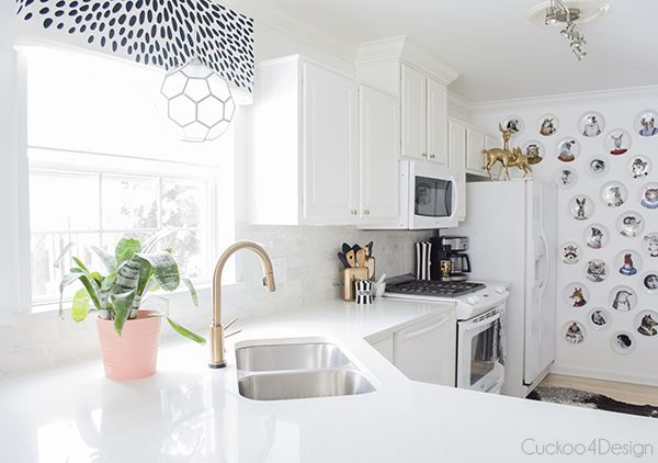 I finally committed to an all white kitchen by painting over my mint kitchen wall. It's so much better and with all the other decor there is still enough interest to not make the white on white boring.