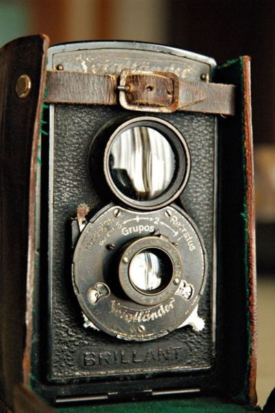 Old camera. Used and loved. LOVE this picture! and I LOVE old cameras!