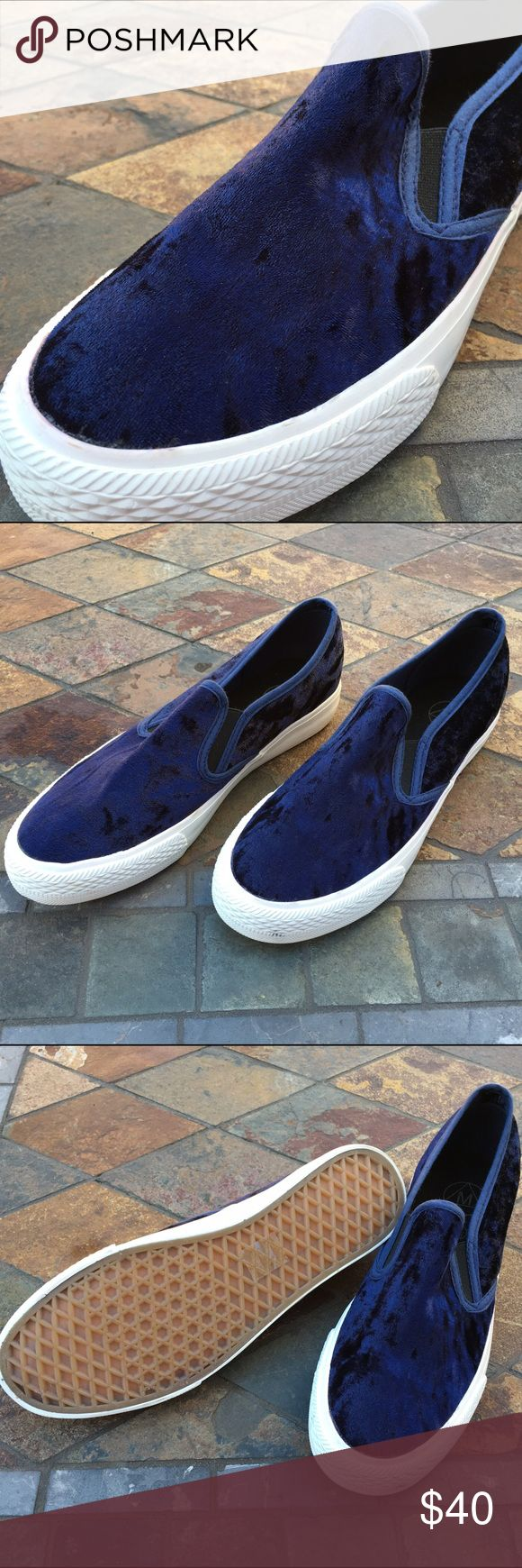"🆕Slip On Sneakers Dark Blue Velour🍃🍂 Unisex - Dark blue velour slip on sneakers have stretch elastic on both sides of shoe ""tongue"". Makes it easier to slip on and stay on the foot. White edges. **Shoes are labeled Mens 7/40. Will also fit Women's 10/40. Measurements are 10"" long from toe box to heal & 3.5"" widest point before toe box.** Never worn & in excellent new condition. NWT Shoes Sneakers"