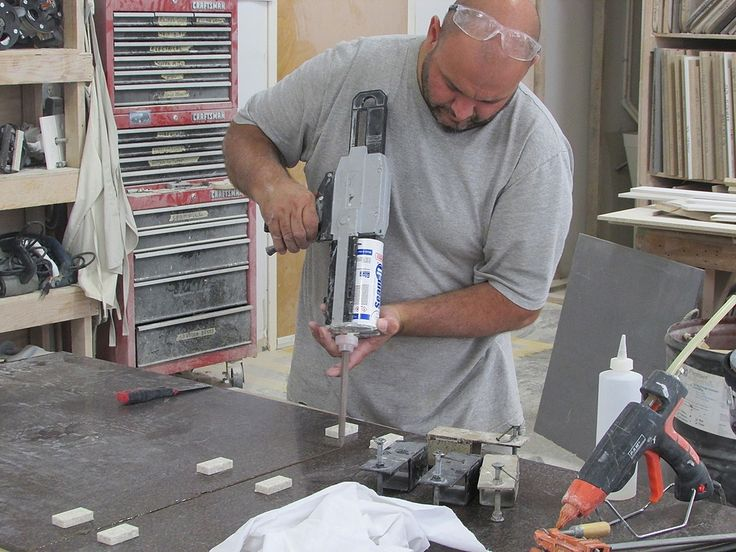 Professional Craftsman busy with making custom countertops