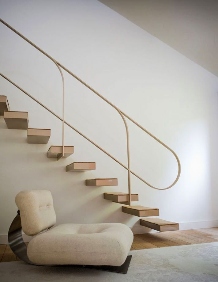 Oscar Niemeyer lounge chair, 1972. Interior design by Buttazoni & Accosiés. / Buttazzoni