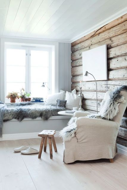 Cozy white summer cottage living room with reading nooks for two.
