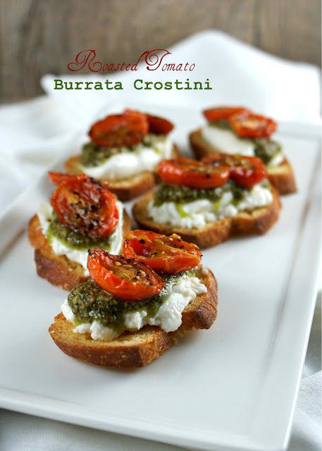 Roasted Tomato Pesto Burrata Crostini--- I think I could substitute mozerella for burrata cheese...