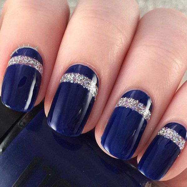 Beautiful looking dark blue nail art design. The blue nail art is framed by a line of silver glitter polish all over the nails making it look uniform and interesting to see.