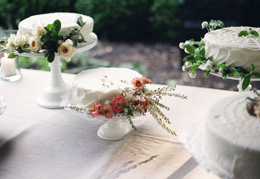 buttercream-frosted cakes decorated with fresh flowers and figs