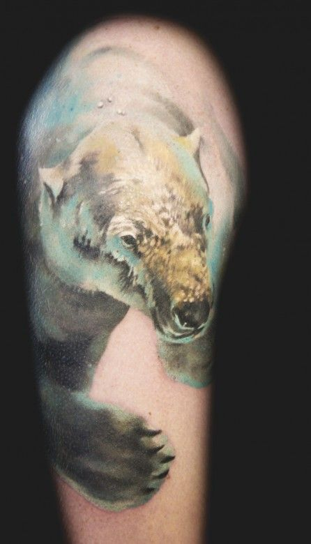 This polar bear looks like he's swimming underwater. Tattoo by Andrey Barkov #InkedMagazine #polarbear #bear #animal #swimming #tattoo #tattoos #inked