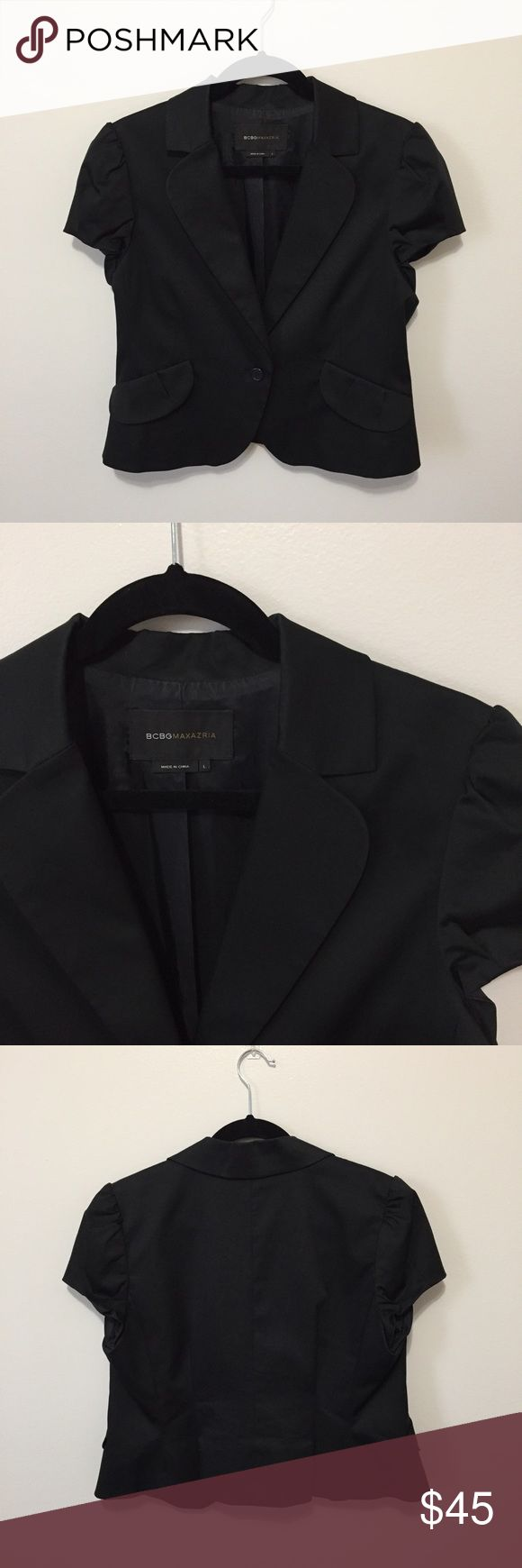 BCBGMaxazria Cap Sleeve Blazer Retail $198. Beautiful black cap sleeve blazer. One button closure. Te faux pockets at front. Lapel with notch. Vented back. Fully lined.  Measurements according to brand: bust 40, waist 32, hips 42.5 BCBGMaxAzria Jackets & Coats