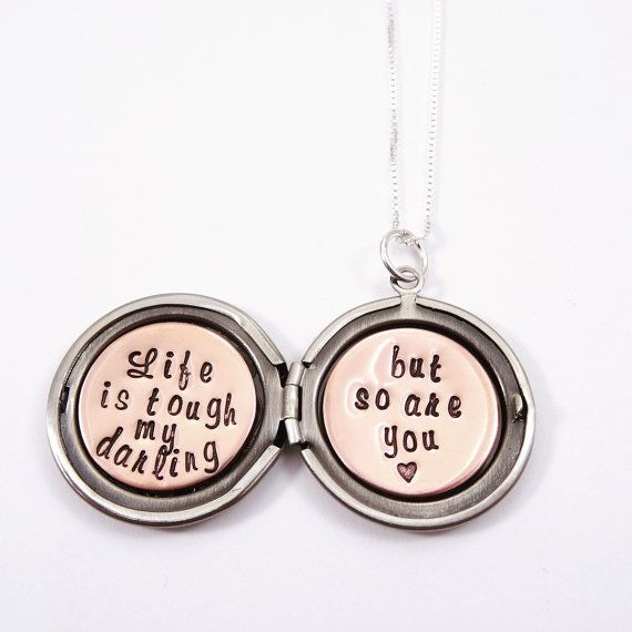 """Who doesn't want to give the perfect gift. Life is tough my darling but so are you or your own personalized message is hand stamped inside this sweet floral locket! It would be hard to find a more meaningful gift.  This silver locket necklace makes a unique and sentimental gift that's perfect for your loved one. _____________________________________________________________________________________  Life is tough locket necklace features: -- 1"""" floral silver locket -- 18"""" sterling silver chain…"""