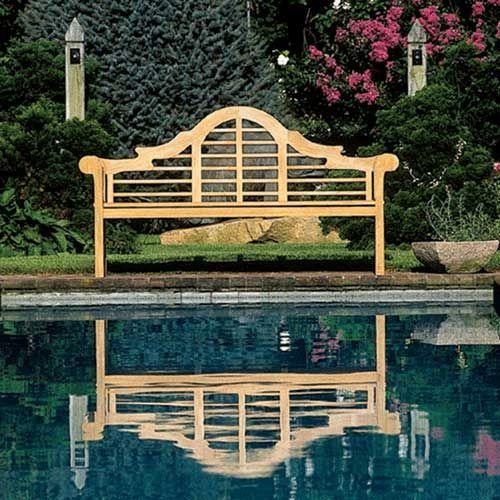Classic, elegant Lutyens bench - tucked among a garden
