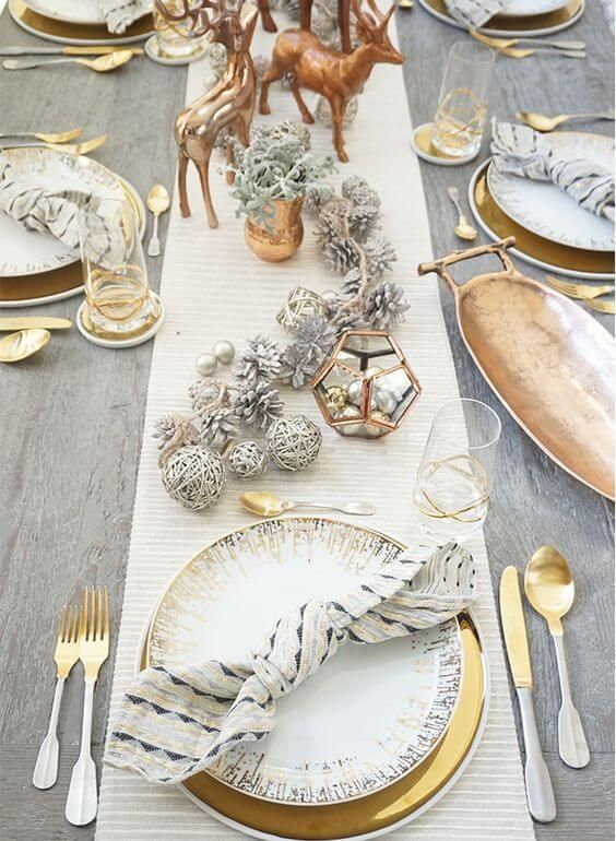 A perfect winter or Christmas wedding table place setting - loving the gold charger plates and forest themed stag decor! See more gorgeous ideas for your winter wedding table place settings and tablescapes on Mrs2be,ie!