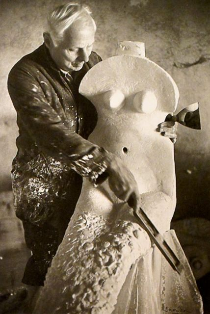 "German Surrealist & Dada artist Max Ernst (1891-1976) ""making love to a sculpture,"" Huismes, France (1963). Photographer & image title unknown. via Mondoblogo"