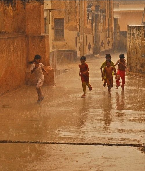 Playing in the rain. *To find out how to sponsor a disadvantaged child's education in India, please go to: www.heal.co.uk
