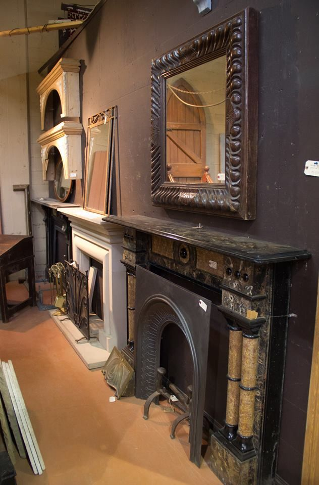 Antique Welsh slate fireplaces and carved stone Bolection fireplace.