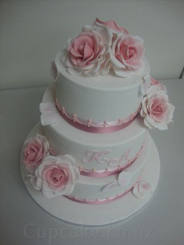 Delicate pink and white wedding cake