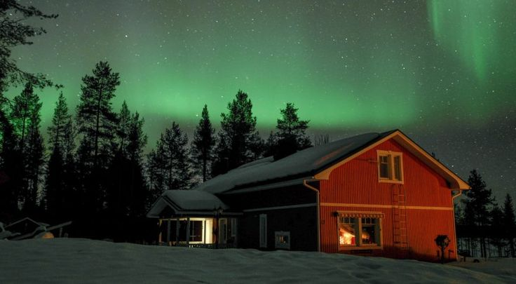 Northern Lights over Puolukkamaan Pirtit in Pello in Finnish Lapland