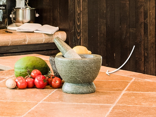 Star Kitchen: Jeffrey Saad from FoodNetwork.com uses a Thai granite mortar and pestle in his kitchen.