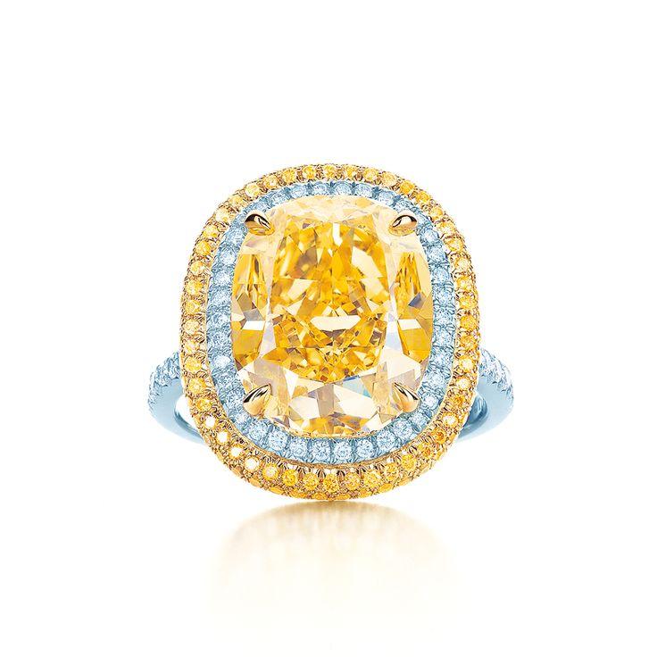 Tiffany & Co. Fancy Vivid yellow diamond ring in platinum with white diamonds. #TiffanyPinterest