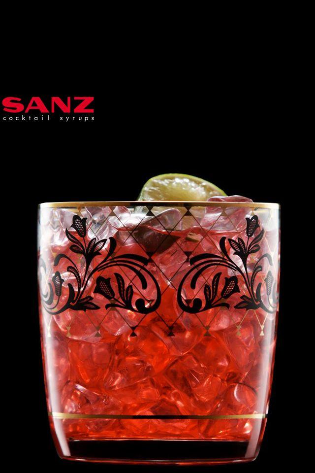 """El jarabe de frambuesa es uno de nuestros sabores #top: """"Raspberry Woo Woo"""" #enjoy!  Os pasamos la receta del día: Método de elaboración: coctelera Tipo de vaso: Old fashioned  2 oz vodka 1 oz licor de melocotón Nordpol 1/2 oz jarabe de frambuesa Sanz Cocktails 3 oz zumo de arándanos  Procedimiento: batir todos los ingredientes en coctelera con hielo y colar en un vaso lleno de hielo. Decoración: Gajo de lima.  #Jarabes #Cocktails #Sirope #mixology #bartender #barman #receta #cocktail…"""