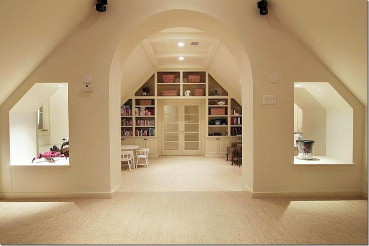 playroom - great idea for bookcases under roof line