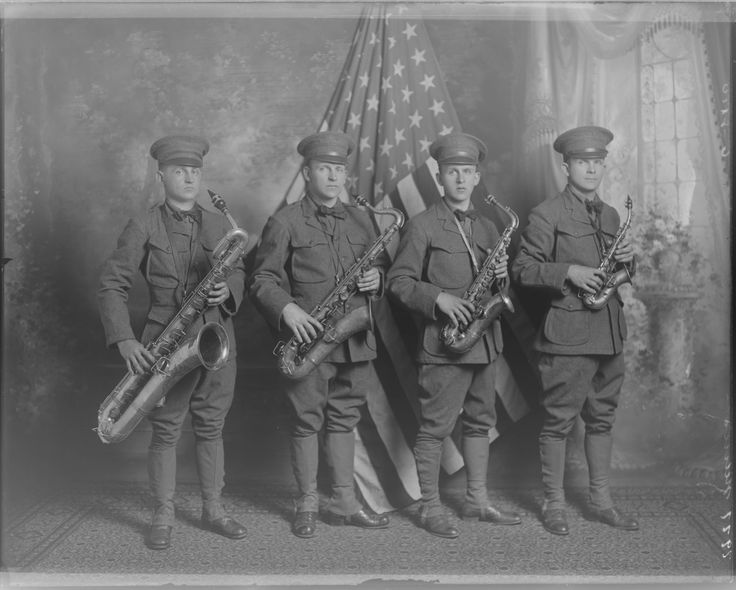 We're used to seeing straight soprano saxophones, but that guy on the right has a tiny curved soprano sax! Also, the baritone sax player thinks he's super tough looking, but we have some saxophone jokes sure to make him chuckle. Musical groups and performances, 1920s :: Milwaukee Polonia Digital Collection