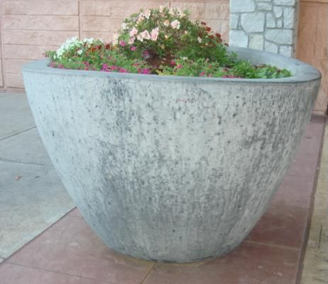 TREE WITH PLANTER [USD 2000].  A large planter with a small tree is located within the curvilinear seating for a bit of shade, air filtering, and touch of green