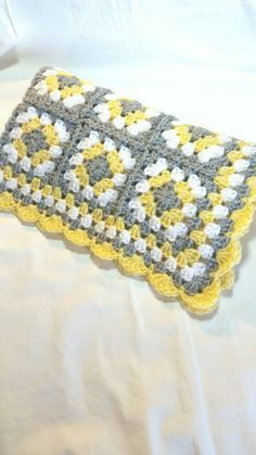 Handmade Granny Square Baby Blanket.  Color: Yellow, Silver Gray, and White.  Custom Made: Please allow 5 days from purchase for shipment of blanket.  Made from 100% soft acrylic yarn. Machine washable and dryable.  Measures 32 x 27 & is a great size for babies car seat, stroller, or crib.  Great as a shower gift or as a homecoming blanket for your new baby.  Comes from a non-smoking home.  Please contact me if you have any questions & check out my store for more handmade items.  Custom…
