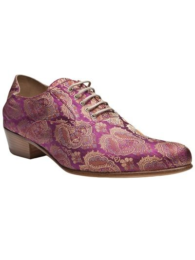 Brocade oxford shoe in purple from Haider Ackermann. This silk oxford features a pointed toe, five-eye lace-up panel, and stacked wooden heel. Heel measures 1.25