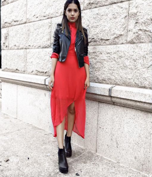 8 fall fashion outfit ideas to copy from the best blogger Instagrams of the week: Arushi Khosla wears a red dress under a black leather moto jacket.