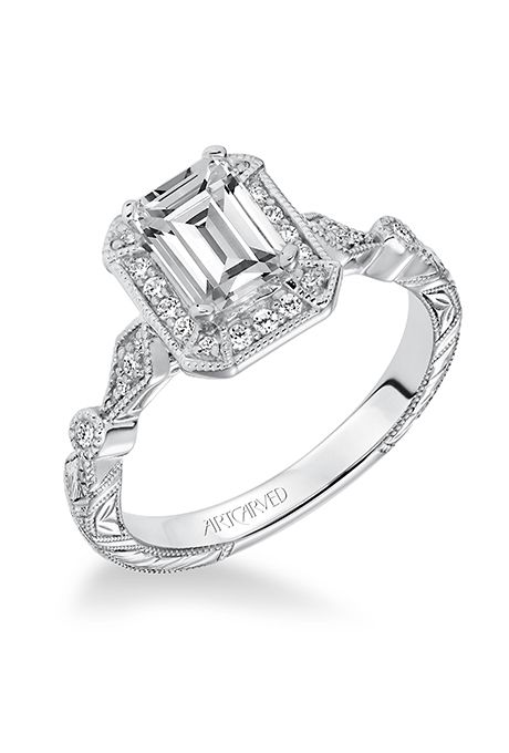 "Brides.com: . Style V634, ""Georgina"" vintage-inspired prong-set halo engagement ring with hand engraved and milgrain details, $1,500 (for setting only), ArtCarved"