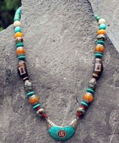 Necklace made of DZi beads, amber beads and turquoise beads