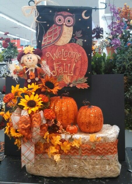 Hay bale arrangement at different angle with pumpkins and a flag made by sunni lorber at ac moore