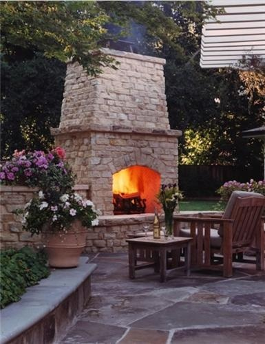 The sturdy lines and natural colors of this beautifully-crafted outdoor fireplace would go perfectly with the architecture of a Craftsman home. Design by SDG Architects in Redwood City, CA.