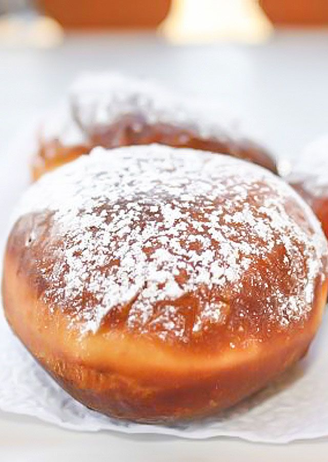 Filled Donuts (Paczki) - a delicious Polish donut called Paczki, popular on Fat Tuesday, filled with Saskatoon berry jam.