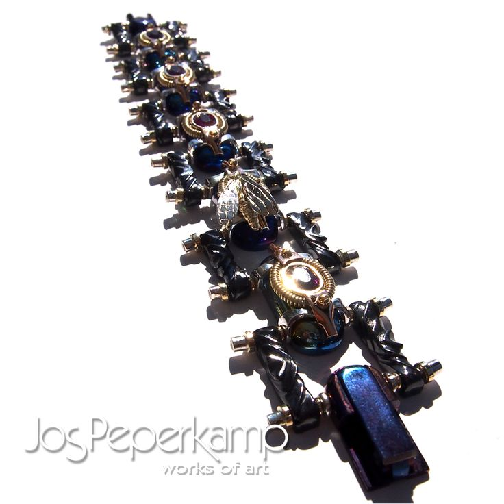 Jos Peperkamp works of art, inspired by STEAMPUNK this bracelet, made of titanium, zirconium, red, white and yellow gold, silver, 5x Red Beryl and 24 diamond total 1.20 ct 2