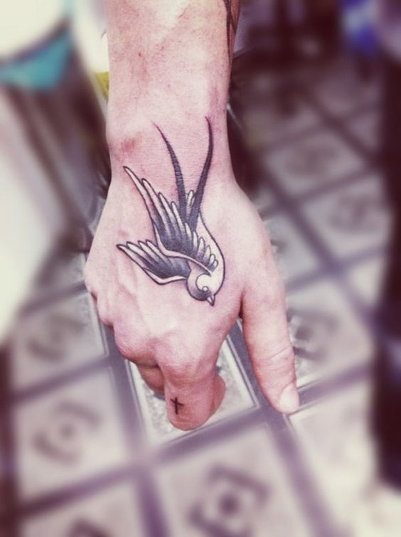 Swallow tattoo on hand - 50 Lovely Swallow Tattoos   Art and Design: