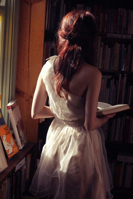 Redheaded girl with book