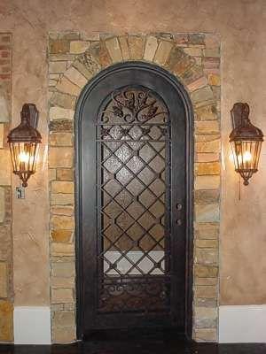 Wrought iron wine cellar door.