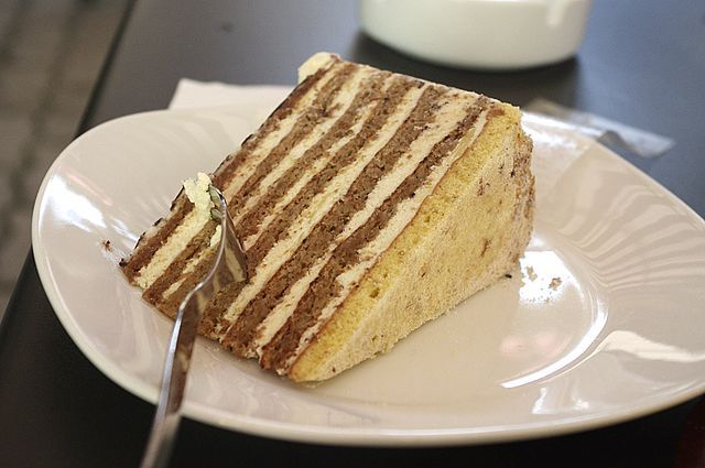 Esterhazy torte is a rich dessert consisting of chocolate buttercream sandwiched between four layers of sponge cake.