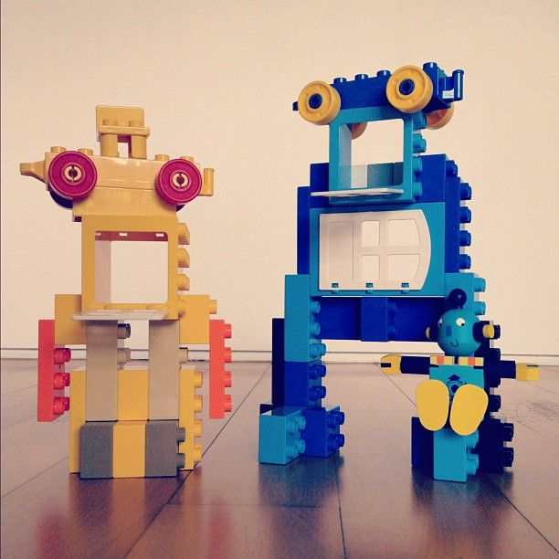 Our own Lego Duplo playground with working props. A pair of robots with tonguepolines.